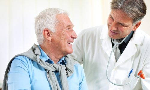 close up of a male doctor discussing with senior man
